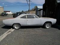 this is a 1968 roadrunner with 4 speed and 440 engine.