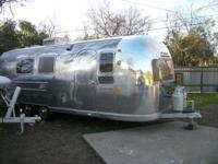 This is an initial 1969 Airstream in magnificent