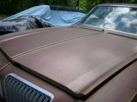 Various 1974 Oldsmobile Omega parts for sale. Hood in