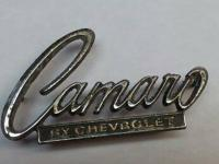 "ORIGINAL 1969 ""Camaro by Chevrolet"" header emblem."
