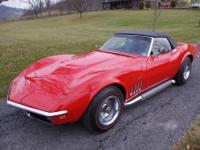 1969 Corvette Convertible. Monza Red exterior with a