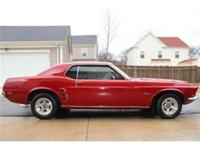 Vintage cars, such as the 1969 Mustangs, are a perfect