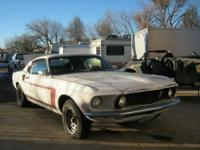 This is a 1969 Ford Mustang Fastback. It is a 302 2