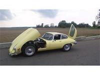This is a beautiful 1969 Jaguar E-Type FHC, Primrose