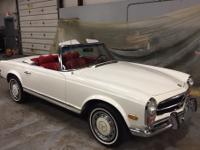 This is a 1969 Mercedes 280SL with automatic