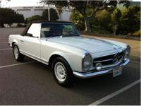 A beautiful white over blue Mercedes 280SL with rare