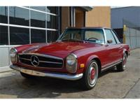 1969 Mercedes Benz 280SL. Burgundy with black interior.