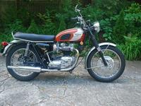 This is a 1969 Triumph Bonneville T120R with matching