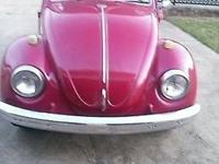 This is a 1969 VW BEETLE DELUXE SEDAN, a one owner car,