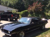 Beautiful black 1969 Camaro.I have owned since