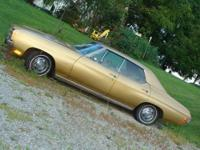 This is a 1970 Chevelle Malibu. It is a four door with