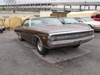 A 1970 Chrysler Newport 300 convertible with a 440/375