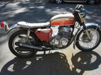 1970 Honda CB750 Sandcast.side covers have fractures
