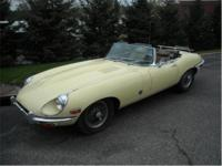 1970 Jaguar XKE Roadster. Yellow with black interior.