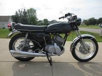 You are looking at my 1970 Kawasaki H1 500 Mach III