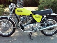 This bike has been totally restored however not to