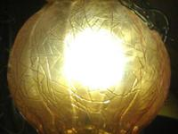 We have a 1970's Amber Globe Hanging Light. It is in