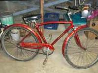 THIS IS A 1970'S RALEIGH SPACE RIDER. IT IS A FIRE RED