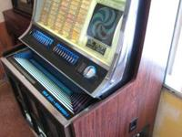 Up for sale is a Rock-ola 445 100 option juke box made