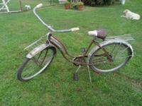 All original, consisting of tires, pedals, seat, front