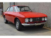 1971 Alfa Romeo GTV Coupe. Red with black interior.