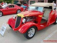 The Chevrolet motor is a stock 396 big block with stock