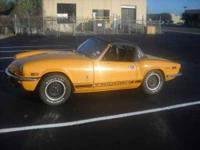 The 1971 is the ORANGE maverick! 2 door. Engine and