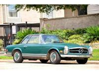 1971 Mercedes Benz 280SL. Dark green with brown