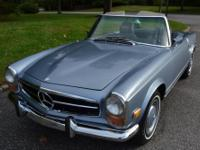 This is a 1971 Mercedes Benz 280SL in excellent