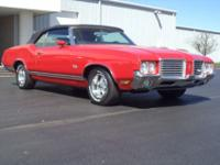 1971 Oldsmobile Cutlass in fiery Red exterior and Black