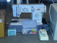 Sewing machine is made by White and is model 603. This