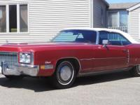 This is an ORIGINAL Coronation Red 1972 Cadillac