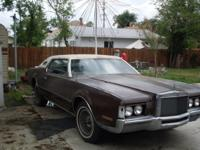 This is a classic 1972 Lincoln continental 2 door coupe
