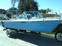 1972 Manatee twin console with 1977 Evinrude, version