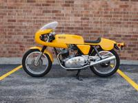 This is an immaculately restored Norton Commando 750