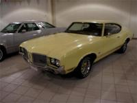 You are looking at a Sunfire Yellow Cutlass S in nice