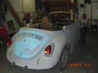 I HAVE A 1972 V.W. SUPER BETTLE AUTO-STICK CONVERTIBLE,