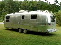 This Vintage 1973 29ft AIRSTREAM AMBASSADOR Travel