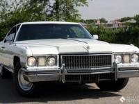 This certain 1973 Cadillac Coupe Deville is finished in