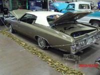 This is a beautiful 1973 Chevy Impala. Show car or