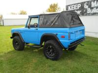 Beautiful 1973 Ford Bronco Grabber Blue for sale.