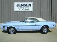 This 1973 Ford Mustang is in a beautiful Light Blue