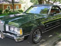 This green Cougar convertible is in good condition. It