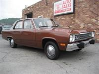 This 1973 Plymouth Valiant 4dr 4-door Sedan features a