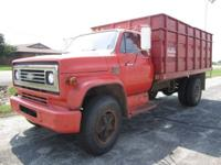 Check out this LOW MILEAGE, local trade-in, grain/dump