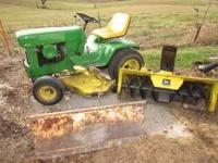 1974 John Deere 140 for sale. This includes a mower