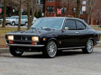SHOW QUALITY MINT RESTORED 1974 MAZDA RX-2 . IT  WAS