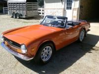 This is a newly painted 1974 Triumph TR6 two-door