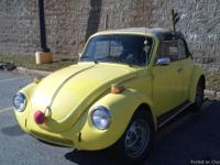 Bright yellow daily-driven 1974 Super Beetle