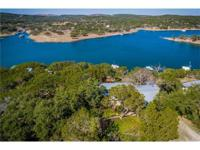 Lake Travis waterfront home with dual slip dock on deep